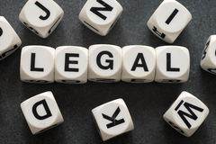 Word legal on toy cubes. Word legal on white toy cubes Stock Image