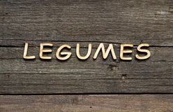 The word of Legumes on a wooden table Stock Photos
