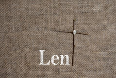 Word Lent with Cross T. Word Lent painted on burlap with a twig cross forming the T Royalty Free Stock Image