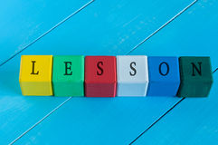 Word Lesson on children's colourful cubes or. Blocks. Colourful wooden education background Royalty Free Stock Image