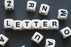 Word letter on toy cubes. Word letter on white toy cubes Royalty Free Stock Image