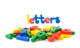 The word letters and lots of colored letters Stock Photography
