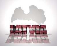 Word Lettonie sur un fond de carte Images libres de droits