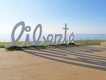 A word Liberte on the embankment of the city of Batumi, Georgia. Summer landscape, modern art.  stock photos