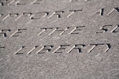 Word Liberty engraved in stone Royalty Free Stock Photography