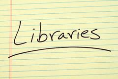 Libraries On A Yellow Legal Pad Stock Photo