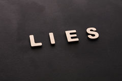 Word Lies on black background Royalty Free Stock Photo