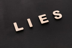 Word Lies on black background Royalty Free Stock Photography