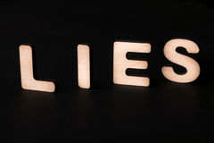 Word Lies on black background Royalty Free Stock Images