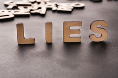 Word Lies standing on table Royalty Free Stock Images