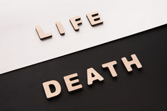 Word Life and Death on contrast background Stock Photos