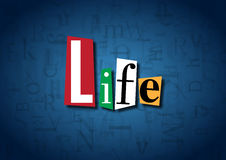 The word Life made from cutout letters. On a blue background Stock Image