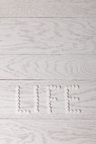 Word life made of pills on table Stock Photos