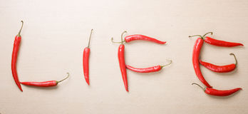 Word Life written with red chili peppers on table Royalty Free Stock Photo
