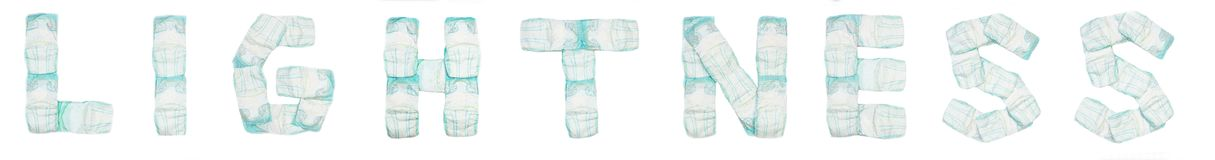 Word lightness laid out baby diapers on a white background, isolate, napkin, inscription stock photography