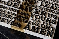 Word of the Lord`s Prayer on the old  black weathered wooden pla. Nk background. Close-up Stock Photos