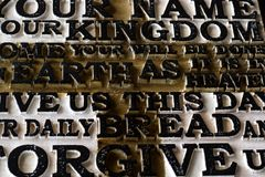 Word of the Lord`s Prayer on the old  black weathered wooden pla. Nk background. Close-up Royalty Free Stock Image