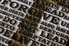 Word of the Lord`s Prayer on the old  black weathered wooden pla. Nk background. Close-up Stock Photo