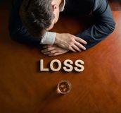 Word Loss and devastated man composition Stock Image