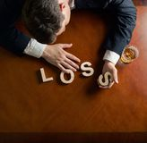 Word Loss and devastated man composition Royalty Free Stock Photography