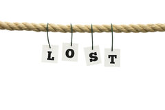 Word - Lost - hanging from a rope over white Stock Images