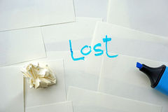 A word lost message on white paper Royalty Free Stock Photography