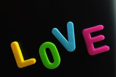 Word of love. Magnetic letters,with different colors forming the word love Stock Images