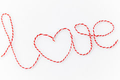 Word love. Written with red and white treads against white background Stock Photography