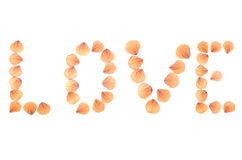 Word Love arranged from dry real rose petals. Royalty Free Stock Photos