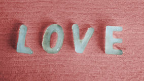 The word Love as ice cubes Royalty Free Stock Photo
