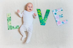 Word love with baby legs stock photo