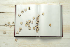 The word love on background of book Stock Image