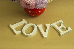 The word love. On a background of brown kraft paper Royalty Free Stock Photography
