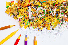 The word LOVE on the background of pencil shavings Royalty Free Stock Photos