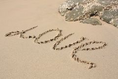 Word LOVE on the beach Stock Images