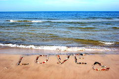 Word LOVE on beach sand Stock Image