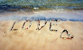 Word LOVE on beach sand royalty free stock photo