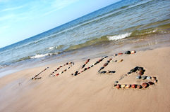 Word LOVE on beach sand Royalty Free Stock Photo