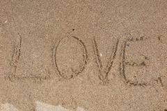 The word love on beach with wave Stock Photo