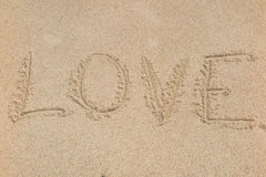 The word love on beach with wave Stock Photography
