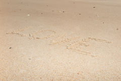 The word love on beach with wave Royalty Free Stock Photo