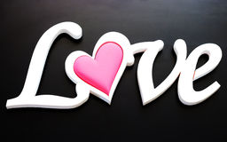 The word love on a black background Royalty Free Stock Photos