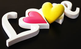 The word love on a black background Stock Image