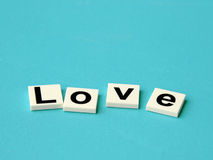 Word love on blue background Stock Photography