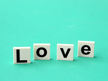 Word love on blue background Royalty Free Stock Images