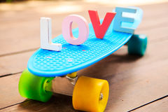 Word love on the blue penny board Royalty Free Stock Photo