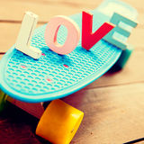 Word love on the blue penny board Stock Image