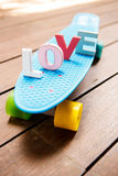 Word love on the blue penny board Royalty Free Stock Image