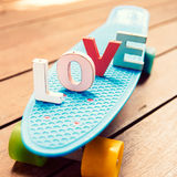 Word love on the blue penny board Stock Images