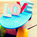 Word love on the blue penny board Royalty Free Stock Images